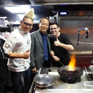 StreetXO chefs around wok