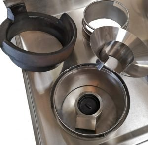 Turbo insert cone shown alongside turbo burner and cast iron ring