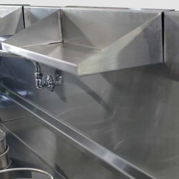 XTRAJ clip-on rear shelf attached to top of splashback